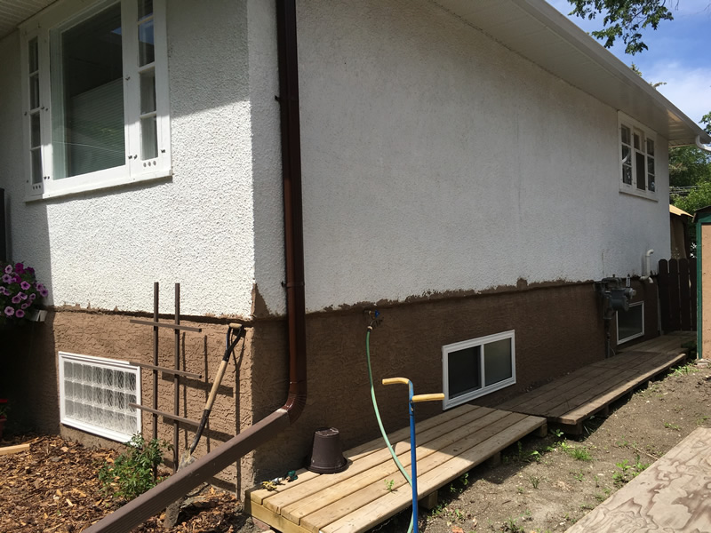 Windows installed and stucco exterior completed