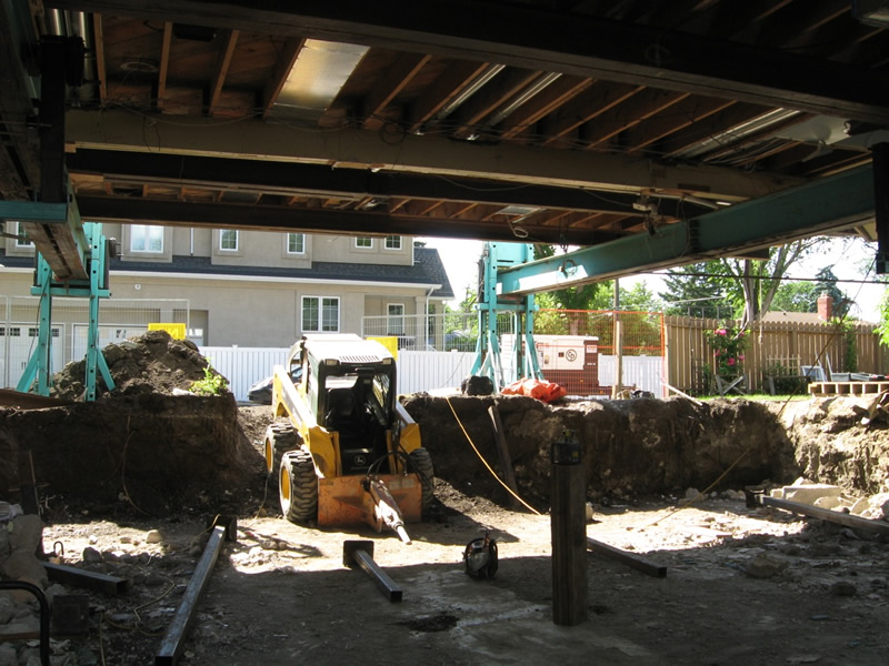 Skid Steer demolishing and removing the old basement